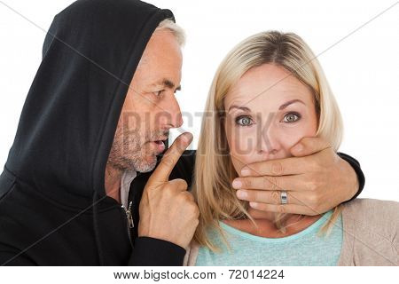Close up of theft covering womans mouth over white background