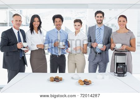 Business team enjoying some drinks at the office