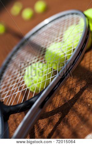 Tennis racket and balls, court