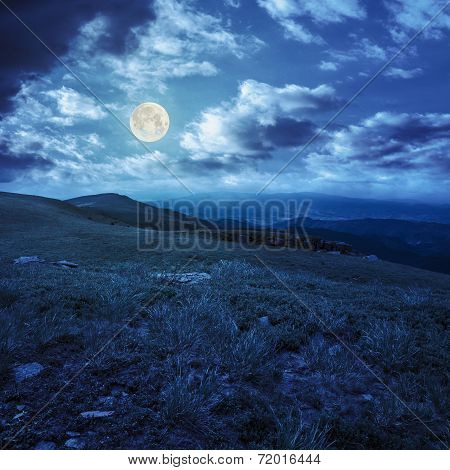 Stones On The Hillside Of Mountain Range At Night