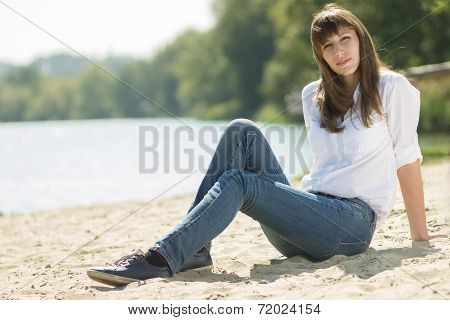 Young Beautiful Woman Resting At The Beach In Summer Midday