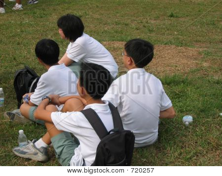 Asian Students In School Uniform Listening Attentively