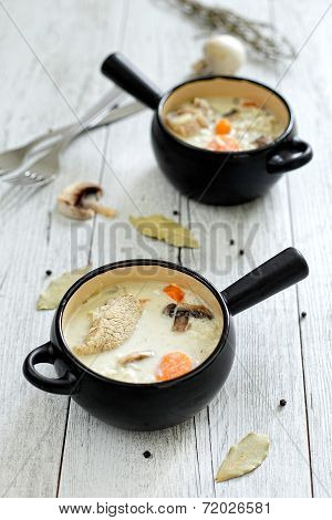 Two pots with veal and cream sauce