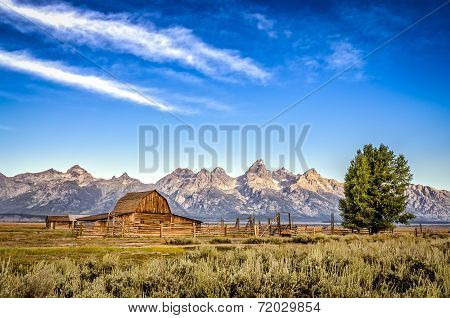 Scenic View Of Grand Teton Mountain Range And Abandoned Barn