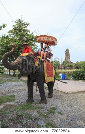 Ayuthaya Thailand-september 6 : Tourist Riding On Elephant Back Past Ancient Pagoda In Ayuthaya Famo