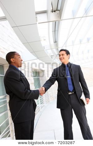 Business Team Handshake At Office