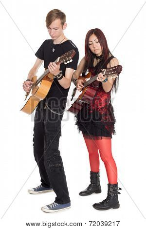 Young musicians play guitars. Interracial young couple, Asian woman and Caucasian man.