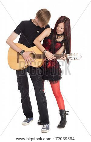 Interracial young couple music. Asian woman and Caucasian man.