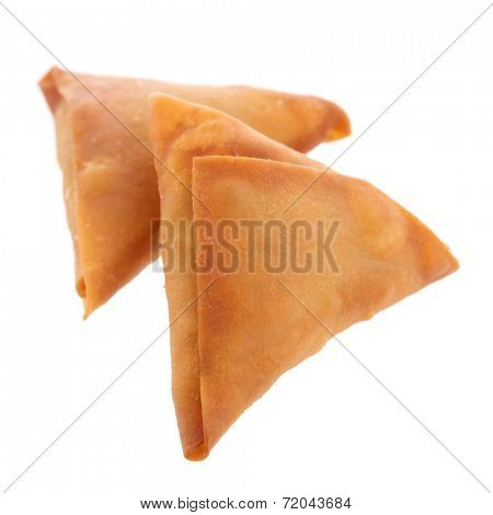 Samosas is a popular snack in Asia, delicious Asian food isolated on white background.