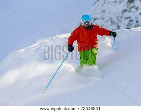 Skiing, Skier, Freeride in fresh powder snow - man skiing downhill