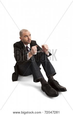 Portrait of handcuffed businessman over white background