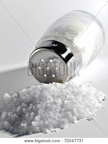 Pile Of Coarse Sea Salt With A Shaker