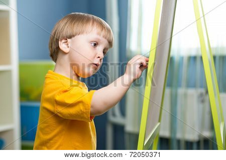 Child Boy Draws On Chalkboard