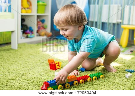 Kid Boy Playing With Construction Toys Indoor