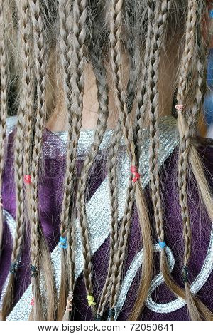 Girl's Plaits On The Fabric Pattern Of Suit