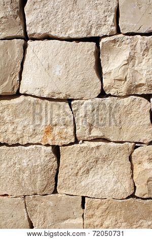 Ancient wall of stone blocks