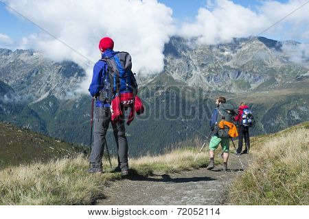 COL DE BALME, FRANCE - SEPTEMBER 01: Backpackers looking at view with Aiguille de Loriaz in the background. The area is a stage of the popular Mont Blanc tour. September 01, 2014 in Col de Balme.