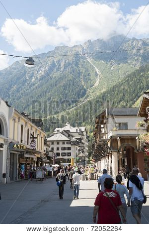 CHAMONIX, FRANCE - SEPTEMBER 02: Pedestrians walking around Chamonix city centre. The city is one of the stages in the popular Mont Blanc tour. September 02, 2014 in Chamonix.