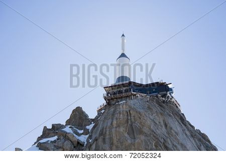 CHAMONIX, FRANCE - SEPTEMBER 02: Low angle shot of Aiguille du Midi complex. At 3842 meters, the complex offers close views of the Mont Blanc summit. September 02, 2014 in Chamonix.