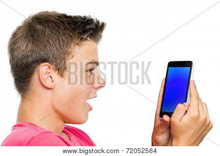 Teen Boy Looking At Smart Phone Surprised.