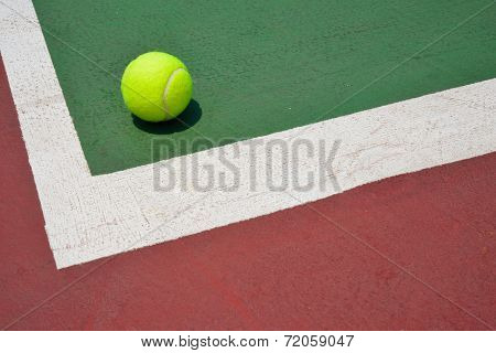 Tennis Ball On Green Old Court