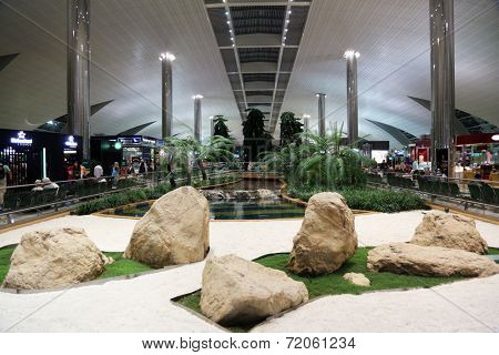 DUBAI - FEB 18: Recreation area in International airport on February 18, 2012 in Dubai, UAE. The airport is major aviation hub in the Middle East with max throughput of 80 millions passengers per year