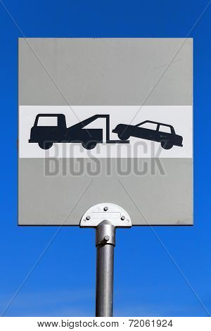 Evacuation. Road Sign Above Blue Sky Background
