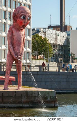 Helsinki, Finland - September 13, 2014: Peeing Red Giant On The Embankment In Center Of Helsinki