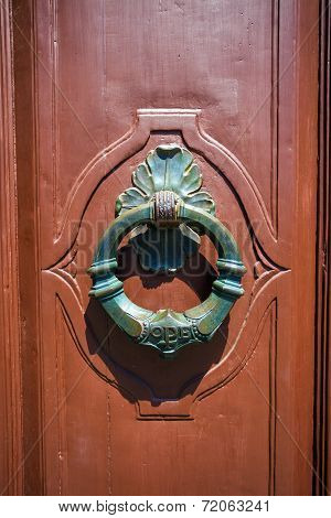 Traditional Knocker Shaped Metal On A Brown Door