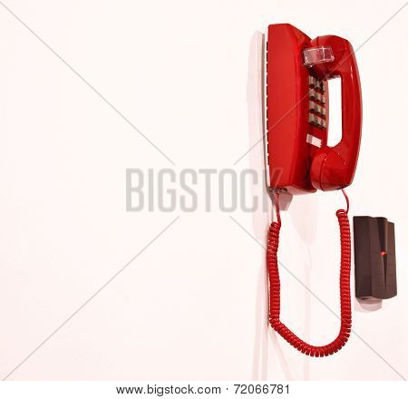 Emergency phone hanging on a wall.