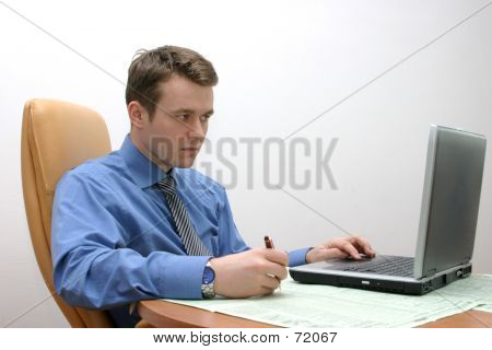 Businessman With Laptop, Focused On Data