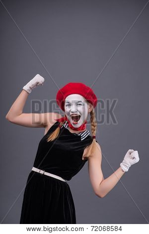 Portrait of female mime with white funny face