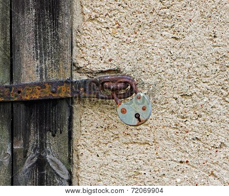 Old Lock  On The Wooden Door