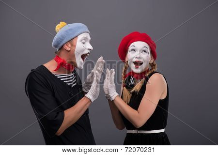 Portrait of funny mime couple with white faces and emotions