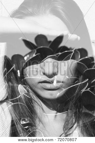 Double exposure portrait of young lady combined with photograph of nature