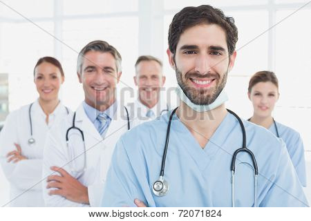 Smiling doctors all standing together as they work
