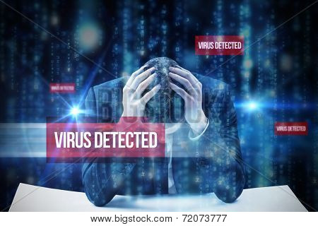 The word virus detected and businessman with head in hands against lines of blue blurred letters falling