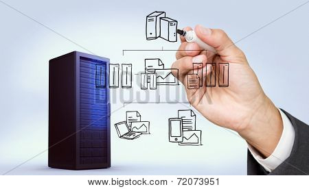Hand holding a marker against digitally generated black server tower