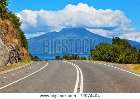 Scenic highway in South America - Carretera Austral. The road leads to the famous volcano Osorno. Top of the volcano cloud closed