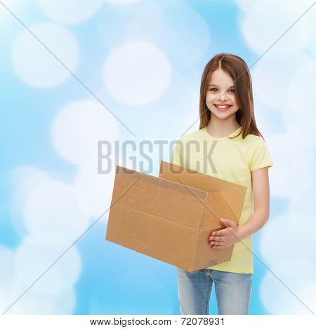 advertising, childhood, delivery, mail and people - smiling little girl holding open cardboard box over blue background