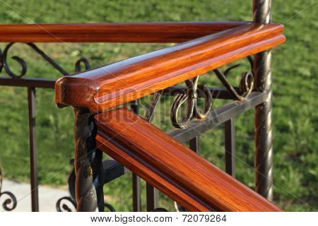 Wooden Hand-rail And Fence On Defocused Grass Background