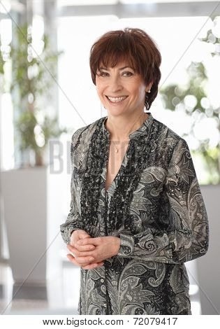 Portrait of happy smiling mature businesswoman, looking at camera.