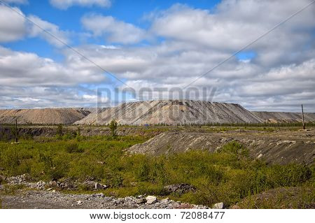 Human-made Hills Of Ore Nearby Open Mine Looking Like Real Hills And Showing Impact On Nature