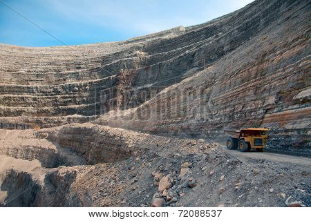 Modern Diamond Mine In Udachny, Russia. Large Truck Transports Diamond Ore From The Open Cast Mine.