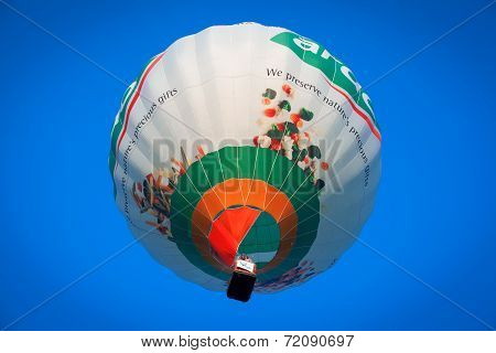 Colorful flying balloon in blue sky