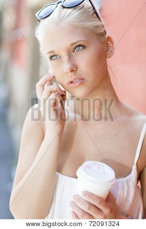 Urban girl talking on the phone in city