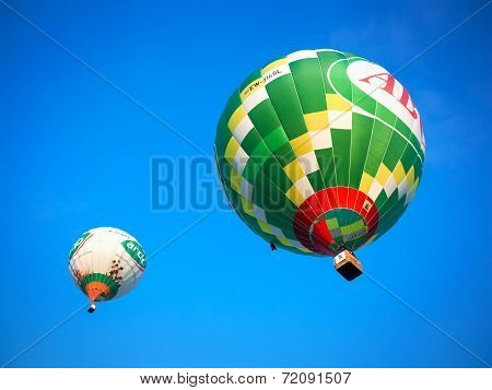 Colorful flying balloons in blue sky