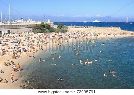 Antibes, France - Aug 27, 2014: People Relaxing On Public Beach