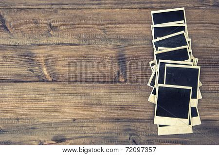 Old Instant Photo Frames On Rustic Wooden Background