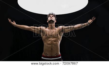 Shirtless Handsome Fit Man With Light Above Him